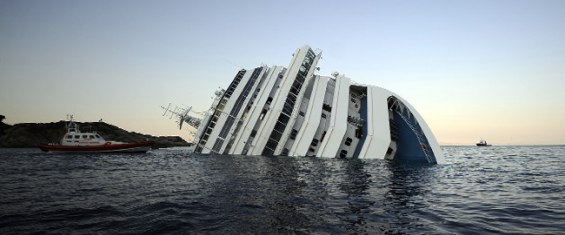 Police arrest Italian captain of cruise ship that ran aground, killing 3 - CNN.com.jpg